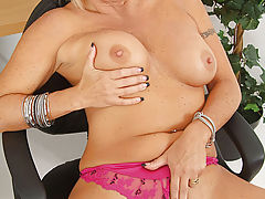 Mouth watering blonde Anilos removes her bra and cups her massive breasts
