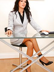 Sex Office, The ever so delightful Lou L looks amazing as she teases from her gorgeous grey suit skirt