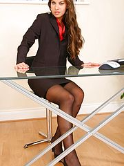 NaughtyOffice, Michaela looks delightful as she slowly removes her sexy skirt suit to reveal her gorgeous black stockings and suspenders