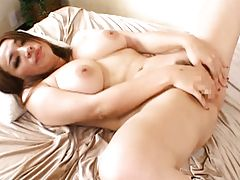 Risa Hayama spreads her legs and plays with her wet pussy